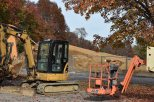 Construction vehicles are seen in front of the bare lot that used to be Slate Run Elementary School. The construction crew has taken the original building down to build a new one. Photo by Tori Roberts.
