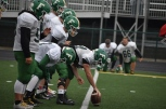 The offensive side lines up after a huddle during the scrimmage. The players scrimmage during practice in order to simulate their next game against Columbus East tonight. Photo by Tori Roberts.