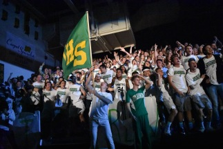 The FC student section and Kilt Krew go wild as the players are announced for the starting lineup. The night's theme was white out, and not a single student went without Floyd Central's 'Unfinished Business' t-shirts. Photo by Tori Roberts.