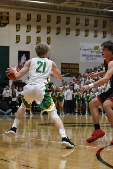 Senior Gabe Shireman takes on the defense in the last quarter. The tension between the teams and fans was high. Photo by Tori Roberts.