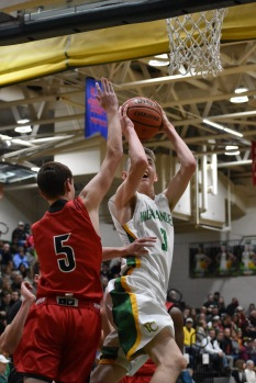 Freshman Jake Heidbreder goes up for one of the first shots of the game. Although New Albany's JV team got the first two points of the night, the Highlanders did not let that affect them. Photo by Tori Roberts.