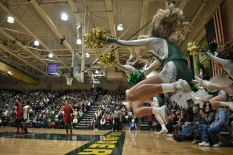 Floyd Central cheerleaders jump up in celebration as Floyd gains another two points. Cheerleaders from both schools lined the outsides of the court, constantly keeping the fans cheering. Photo by Tori Roberts.
