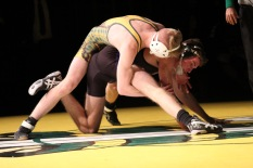 Sophomore Kobe Armes holds a cradle in the third period to end the match with a victory. Photo by Taylor Watt.
