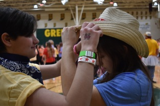 Juniors Jessica Christensen and Trinity Cox dance together while learning the Morale Dance.