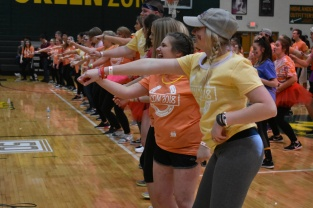 Seniors Darcy Lewis and Emily Stumler dance during the Zumba session.