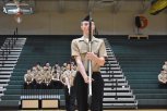 Christian Diers holds his rifle during rotc inspection routine.