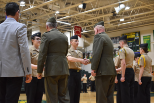 Junior Maddy Adams and Senior Tyler Wilson being congratulated by Lieutenant Colonel Vandermeer and Gunner Epperson