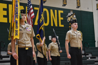 Senior Anthony Worden and senior Sam Epperson preparing to march with flags ending the Rotc inspection.