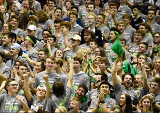 Floyd's Kilt Krew goes wild after Junior Cobie Barnes dunks the ball. The Kilt Krew has always been a huge support for Floyd Central Boy's Basketball, with more than 100 students showing up for the game. Photo by Tori Roberts.