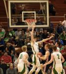 Senior Evan Nichols leaps up to block Bedford from scoring during the third quarter. With a combination of offensive skill and defensive power, it seemed that Floyd Central had already won. Photo by Tori Roberts.