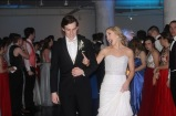 Senior Tux Tuxworth escorts Senior Emeri Ipsan down the cleared dance floor as Prom King and Queen nominees. Photo by Meg Edwards.