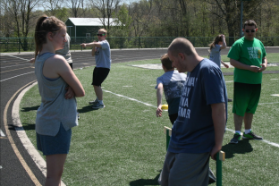 Hallie Stocksdale and Joey Wade stand on the side of the track waiting for further instructions from coach Wad. Photo by Sophia Perigo