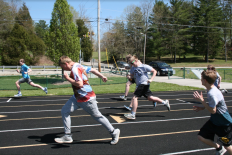 "Unified track gives the kids so much more than physical activity. "" I think the athletes are learning so much more than how to run around a track. They are a learning great social skills and definitely how to work hard,"" said Mazza. Photo by Sophia Perigo"
