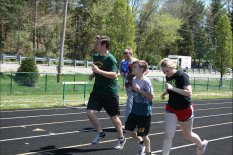 "Sophomore Gracie Roberts warms up with the Unified Track team. "" I help with unified track because I enjoy exercise and I love being with the kids, "" said Roberts. Photo by Sophia Perigo"