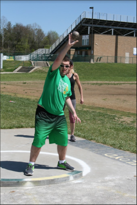 Jacob Alexander throws his trail shot put, he closes the practice with this event. Photo by Sophia Perigo