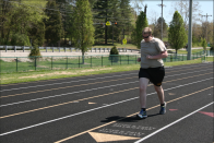 Senior Quinn Morgan runs his warm up laps around the track. The unified track team normally practices for two hours twice a week. Photo by Sophia Perigo
