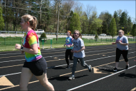 "Senior Cait Saltzgaber runs with Hannah Melton. "" I help with unified track because I love every seconds of it. Being with those kids brightens my day, every day and it's something I look forward to doing,"" said Saltzgaber. Photo by Sophia Perigo"