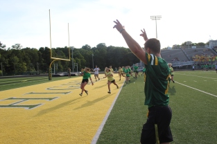 Senior Bison Pirtle cheers as senior Emma Stewart scores the first touchdown of the game, putting the seniors in the lead 6-0 . Photo by Nicholas Gordon.