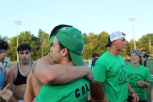 Assistant coach Noah Metts hugs a fan after the seniors take a win. Photo by Nicholas Gordon.