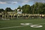 """The juniors line up and turn their backs to the seniors as their names get called out. """"We purposely turned our backs to the seniors; we wanted to show them that we weren't scared,"""" said junior Abby Hart. Photo by Sophia Perigo."""