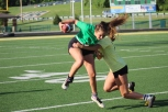 Senior Emma Stewart dodges from getting tackled head on by junior Marlea Ferber. Photo by Taylor Watt.