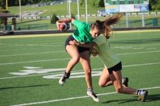 Senior Emma Stewart dodges from getting tackled head on by junior Marlea Ferber. Photo by Taylor Watt.