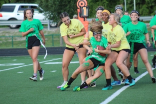 Senior Sara Brown holds onto the ball as she fumbles to the ground after advancing 30 yards. Photo by Taylor Watt.