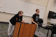 "Senior Jesse Johnson and senior Noah Hankins laugh at a comment made by one of the students that attended the Matilda workshop on Aug. 1. ""The best part of being in theatre is knowing that you're making an impact in somebody's life,"" said Hankins. Photo by Grace Allen."