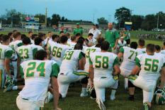 """Coach James Bragg speaks to the players after winning the scrimmage last Friday night. """"The scrimmage is over. It's Male week baby,"""" said Bragg. Photo by Grace Allen."""
