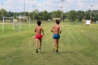 """Junior David Heinemann and sophomore Hunter Griffin begin the course that they were instructed to run on Aug. 2. """"I've been running since 5th grade and I've loved every second of it,"""" said Heinemann. Photo by Grace Allen."""