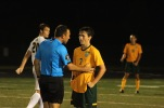 """The referee has a serious talk with Junior Xander Ochsner and gives him a warning during the game. """"I love being a Highlander because no one gets excluded from things,"""" said Ochsner. Photo by Grace Allen."""