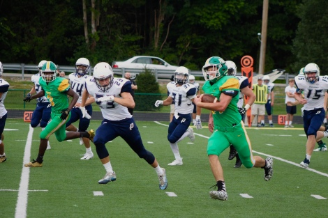 """Senior Tyler Edwards runs the ball through the opposing Providence players. """"I get hyped up when we win or score. It makes me feel great,"""" said Edwards. Photo by Grace Allen."""