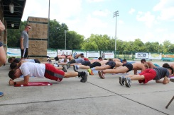 The boys' cross country team does planks during their warm ups. The team practices five days a week and sometimes on Saturdays. Photo by Grace Allen.