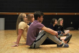 "Senior Jared Dineen sits and listens to audition instructions at the Matilda workshop. ""I am so excited to be a part of a musical production because music is so close to my heart and being able to present that music in such a powerful way would mean so much to me,"" said Dineen. Photo by Grace Allen."