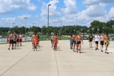 """The cross country team does warm-ups they call """"slow drills"""" before they get into their main workout on Aug. 2. Photo by Grace Allen."""
