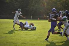 """Senior Bison Pirtle gets tackled by a Charlestown player and is pulled to the ground. """"My favorite thing about football is the adrenaline that you get from playing alongside your brothers,"""" said Pirtle. Photo by Grace Allen."""