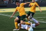Junior Xander Ochsner attempts to get the ball away from the St. Xavier player on Aug 21. Photo by Grace Allen.