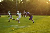 """Sophomore Wenkers Wright avoids being tackled by a Charlestown player and runs the ball as far as he can. """"I play running back and I think it's the best position because in the end, the tougher guy wins so it's all about who wants it more,"""" said Wright. Photo by Grace Allen."""