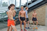 """Junior Wes Jenkins stands with fellow runners while waiting for instructions from Coach Tim Korte. """"My favorite thing about cross country is the bond between all my teammates and my coach,"""" said Jenkins. Photo by Grace Allen."""