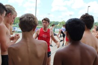 Coach Tim Korte explains the workout to the second group of runners and which course they will take. Photo by Grace Allen.
