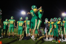 """Seniors Greg Kulwicki and Jon Gunn chest bump after they read the final score of 30-17. """"Scoring or winning at a home game and seeing the crowd go crazy is satisfying,"""" said Kulwicki. Photo by Grace Allen."""