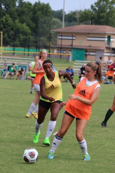 Freshman Mesereti Bitner and junior Celia Dutton race to get the ball during the first half of the game. Photo by Brooke Miller.