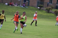 Freshman Ella Lavigne and senior Renee Sisloff focus on rushing to get to the ball before the other team. Photo by Brooke Miller.