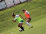 Junior Katie Yankey and junior Bella Crist compete to get the ball as Yankey attempts to score a goal for the gold team. Photo by Brooke Miller.