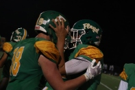Junior Seth Cook and junior Trace Willman celebrate the win against Providence at the end of the game. Photo by Brooke Miller.