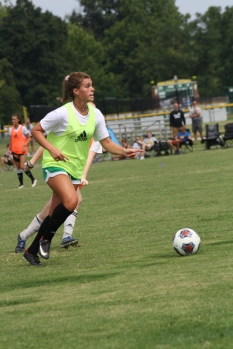 Junior Katie Yankey dribbles the ball down the field ready to advance it to one of her forward teammates. Photo by Nicholas Gordon.