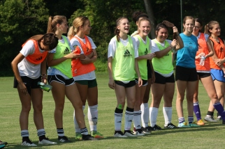 "Before the game, FC girls announce their names so that family and friends will be able to recognize each player..""It's so great being apart of a group of people who all have the same goals and want to push each other to be better everyday,"" says sophomore Maria Hopper. Photo by Nicholas Gordon."