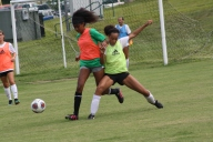 Sophomore Aja Foster and junior Sesan Mesfin battle for the ball to get their team on offense and score a goal. Photo by Nicholas Gordon.