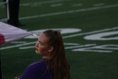 Senior Camryn Schneidau strikes a pose in the middle of the marching band performance. Photo by Sophia Perigo.