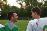 """Coach Mark McKay and junior Luca Innocenti talk about what is going on in the game. """"I watched football in Italy, and I thought it looked fun. So I thought while I was over here I would try it,"""" said Innocenti. Photo by Sophia Perigo."""